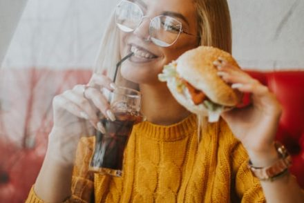 Chillwall Mind blowing restaurantsa lady eating burger, mind blowing restaurants