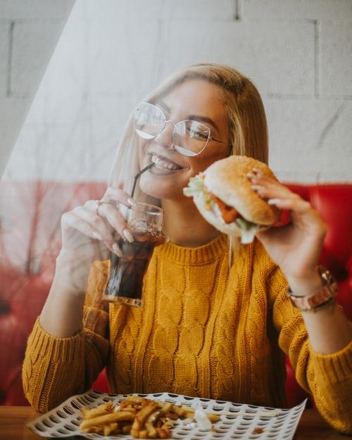 Chillwall Mind blowing restaurantsa lady eating burger, mind blowing restaurants
