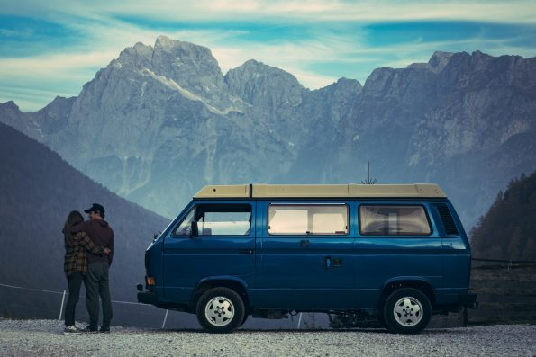 A couple looking at a view next to a van