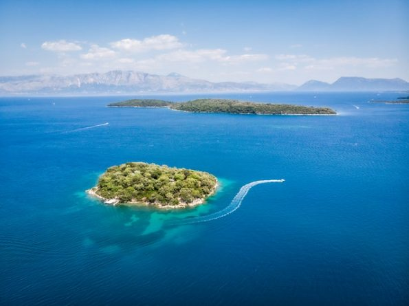 A small and remote tropical island surrounded by the blue sea